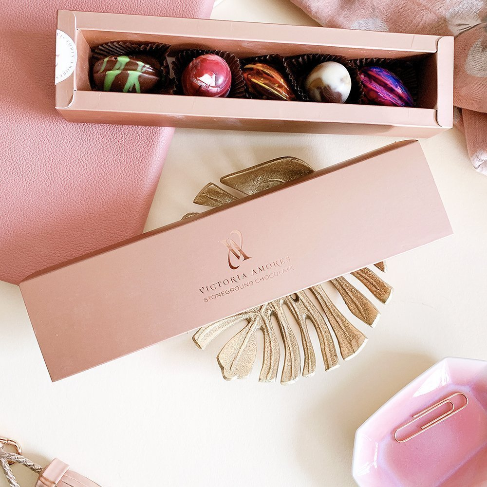 packaging for Victoria Amores Chocolate using the new logo