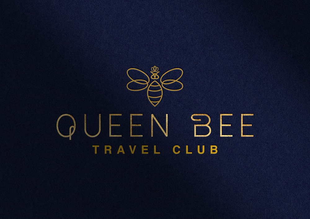 Queen Bee Travel Club primary logo in blue and gold.