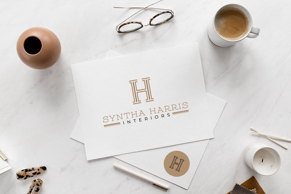 Syntha Harris Interiors logo mockup on paper, submark included