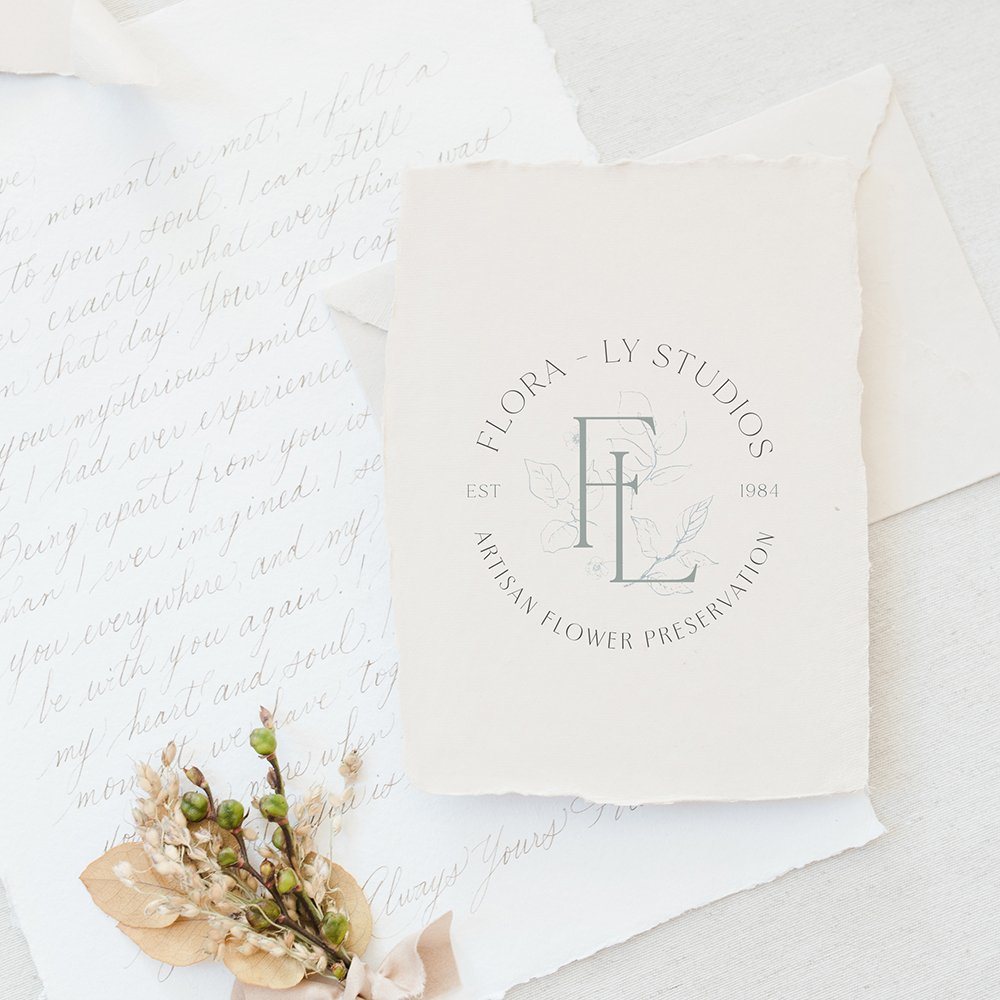 traditional, classic, delicate logo design for Flora-Ly artisan flower preservation | watermark/emblem with floral design